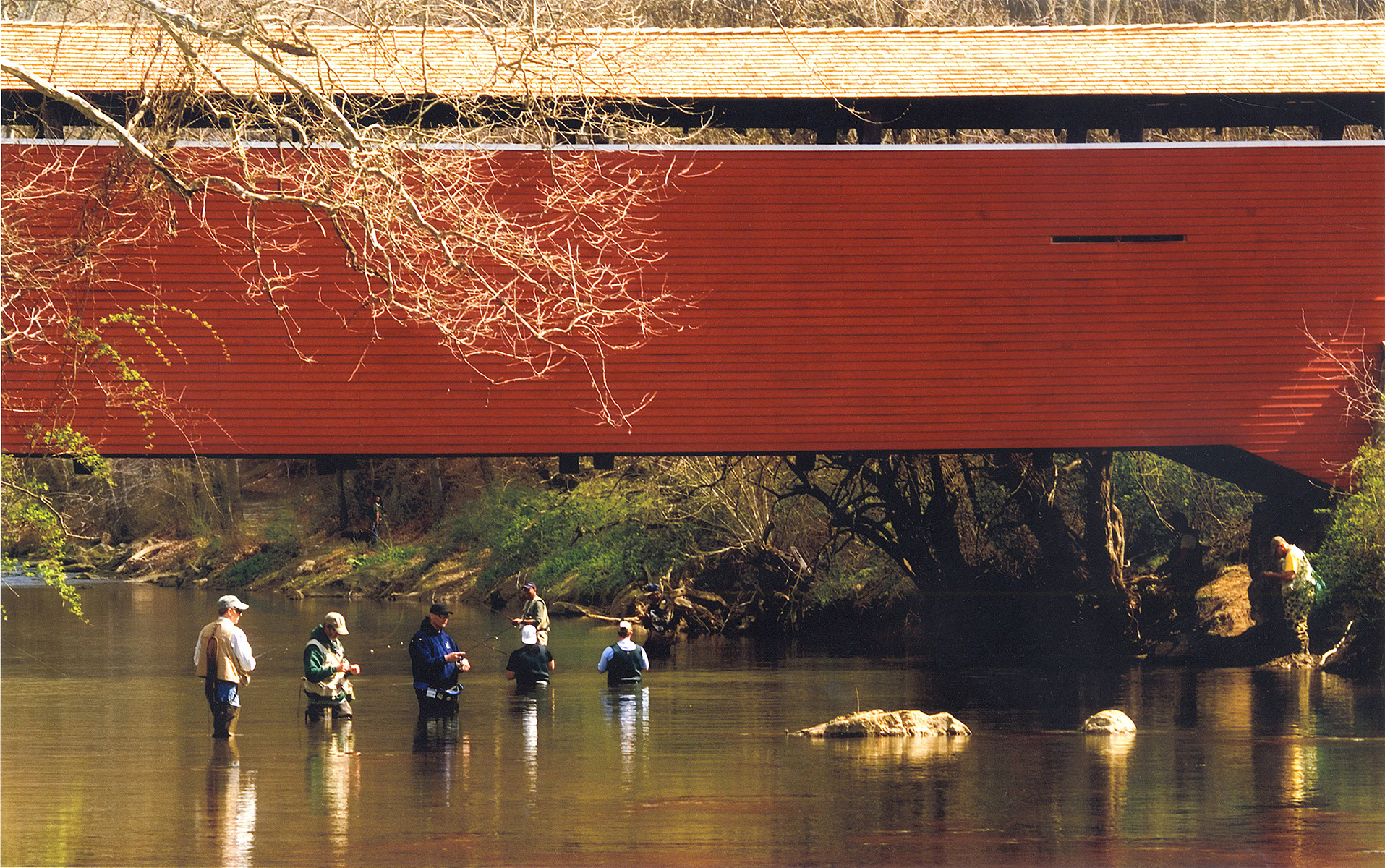 A group of fisherman enjoy a day in the water on one of our many creeks and rivers.