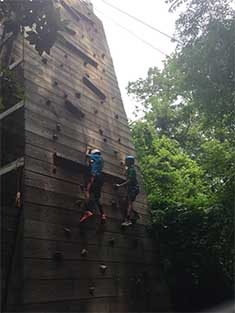 children on a climbing wall