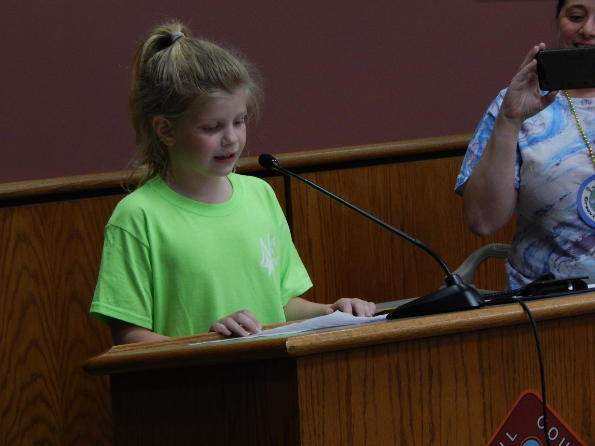 North East Elementary School student accepts Green School status certificate
